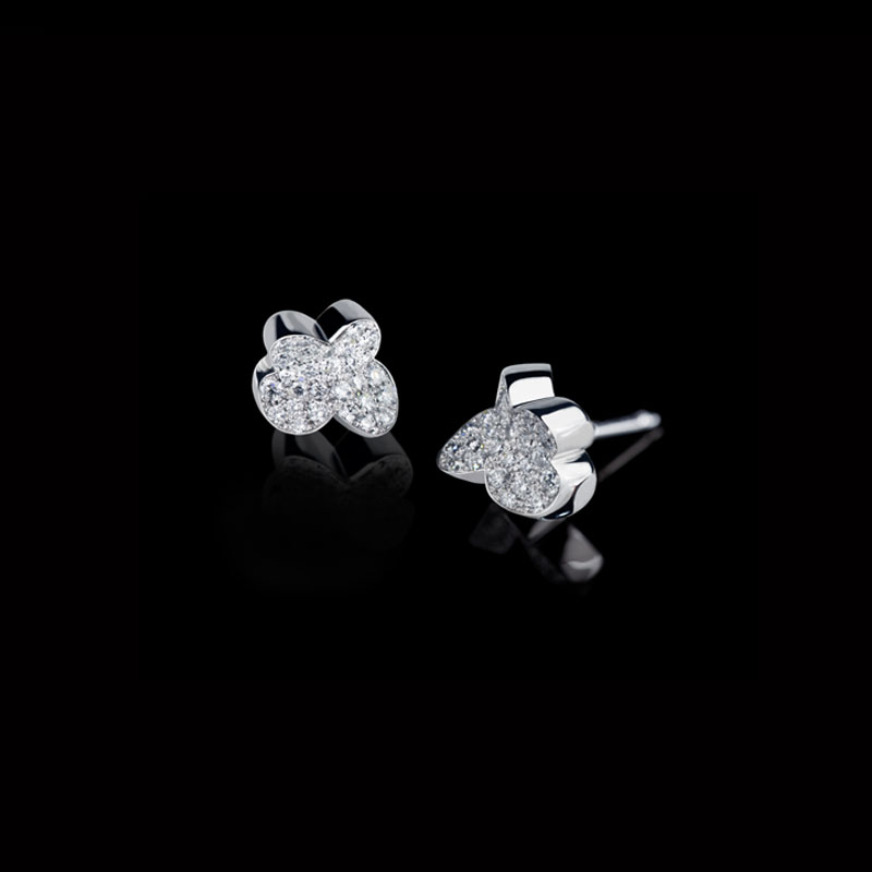 Canturi Odyssey flower stud earrings with diamonds in 18ct white gold.