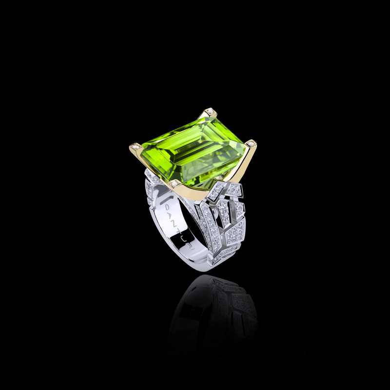 Abstract Cubism diamond ring with emerald cut peridot gemstone set in 18ct white and yellow gold.