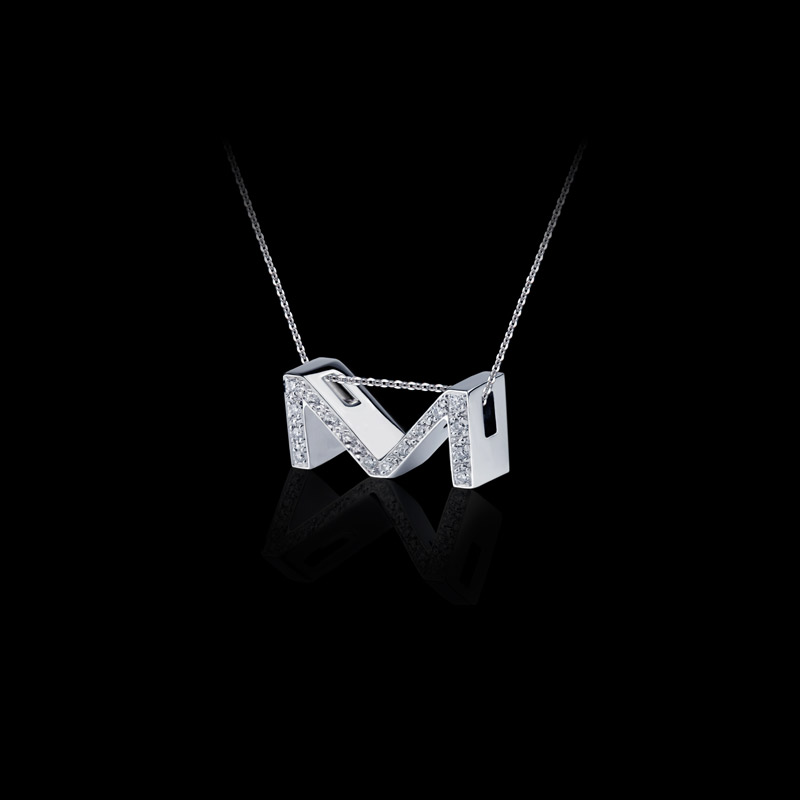 Canturi Alphabet 'M' pendant with pavé set diamonds in 18ct white gold