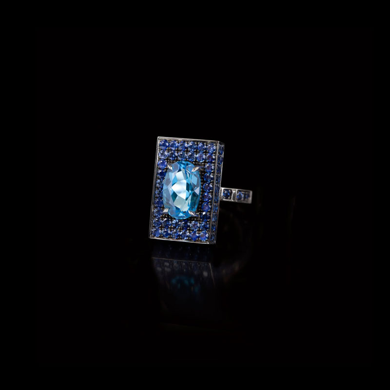 Canturi Captivo ring with blue topaz and blue sapphire in 18kt white gold