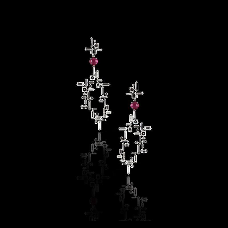 A truely uniquely designed pair of baguette and carré cut diamond ear pendants articulated by a round cabochon cut pink tourmaline gemstone in a Stefano Canturi signature Cubism design