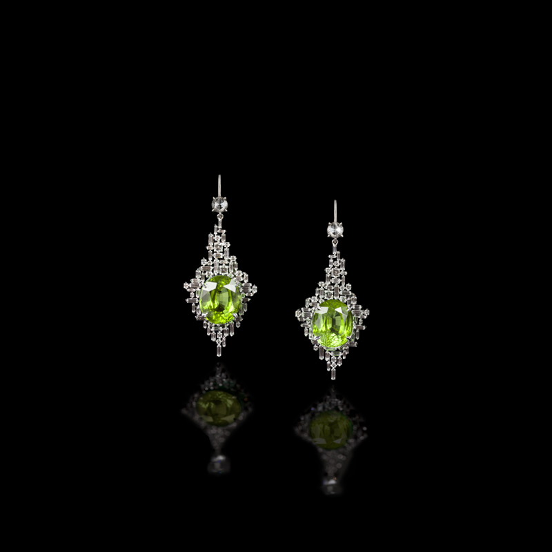 A pair of spectacular diamond ear pendants each set with oval shaped Peridot gemstones, surrounded by baguette and carré cut diamonds in a Stefano Canturi Cubism signature design. Created in 18ct white gold