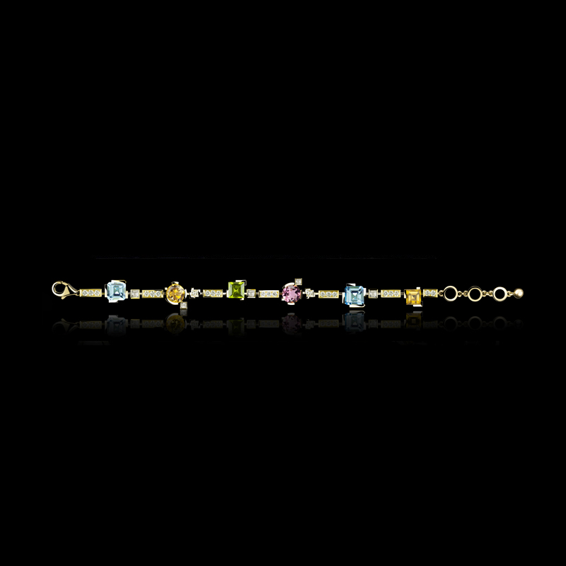 Cubism Colourburst single row bracelet with diamonds, blue topaz, peridot, pink tourmaline and citrine gemstones in 18ct yellow gold.