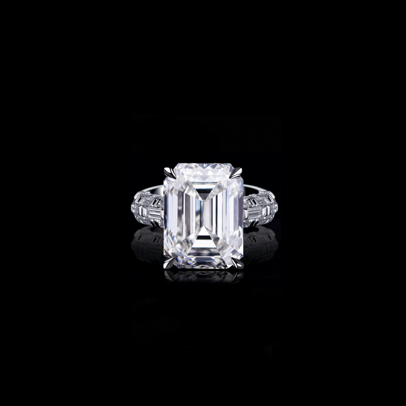 Canturi Bamboo engagement ring featuring baguette cut diamonds in a five row interlocking design with a 4 claw setting, available in emerald cut diamond (shown) or a variety of diamond shapes and sizes. In 18kt white gold, also available in yellow gold or pink gold.