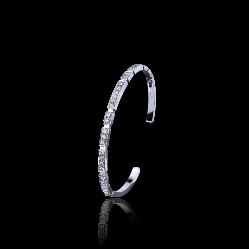 Canturi Eternal Mini Bangle with ruby in 18ct yellow gold. Also available in 18ct white or pink gold.