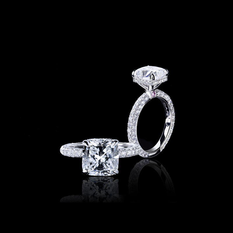 Fine Lumina diamond ring with cushion cut diamond set in the Canturi Secret Halo in 18ct white gold.