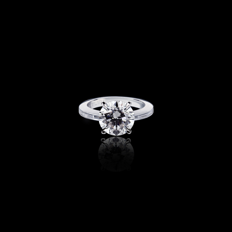 Canturi Needle engagement ring featuring baguette cut diamonds with a round brilliant cut diamond (shown) or a variety of shapes and sizes. In 18kt white gold or also available in yellow and pink gold.