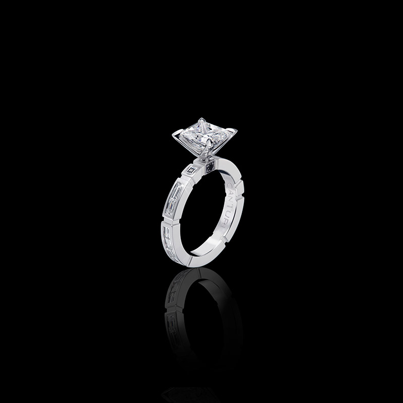 Canturi Regina engagement ring with baguette and carre cut diamonds and single black sapphire detail available in princess cut diamond (shown) or a variety of diamond shapes in 18kt white gold, also available in yellow and pink gold