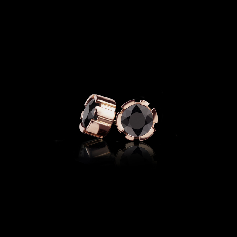 Regina stud earrings with black sapphires set in 18ct pink gold.