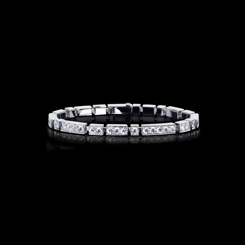 Canturi Regina diamond bracelet with Australian black sapphire detail in 18ct white gold.  A Classic diamond Line bracelet with a modern touch.