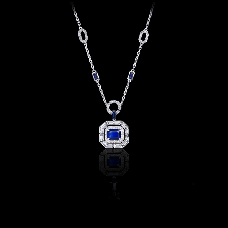 Regina neckpiece with baguette and round brilliant cut diamonds set with an Octagonal Madagascar vivid blue sapphire in 18ct white gold.