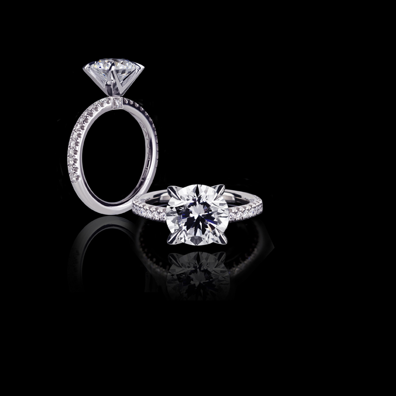 Canturi Renaissance diamond engagement ring with round brilliant cut diamond (shown) or a variety of diamond shapes and sizes, set in a 4 claw setting. In 18kt white gold, also available in yellow gold, pink gold and platinum.