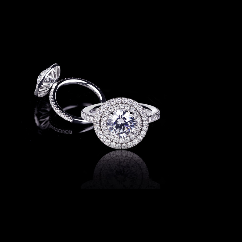 Canturi Renaissance diamond engagement ring in a scalloped set double halo with 'C' gallery under rail, available in a round brilliant cut diamond (shown) or a variety of diamond shapes and sizes. In 18kt white gold, also available in yellow gold, pink gold and platinum
