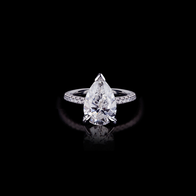 Canturi Renaissance fine micro comfort scalloped ring with a pear shape diamond set in a 4 Dream claw setting. In 18ct white gold, also available in yellow gold, pink gold and platinum.