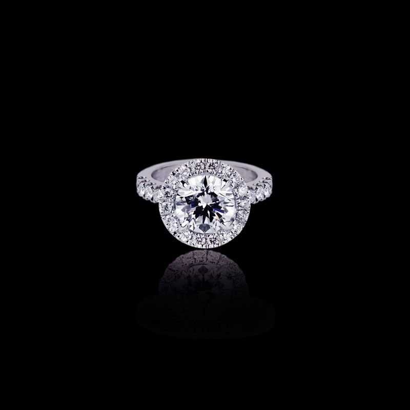 Canturi Renaissance diamond engagement ring in a scalloped set halo available in a round brilliant cut diamond (shown) or a variety of diamond shapes and sizes. In 18kt white gold, also available in yellow or pink gold.