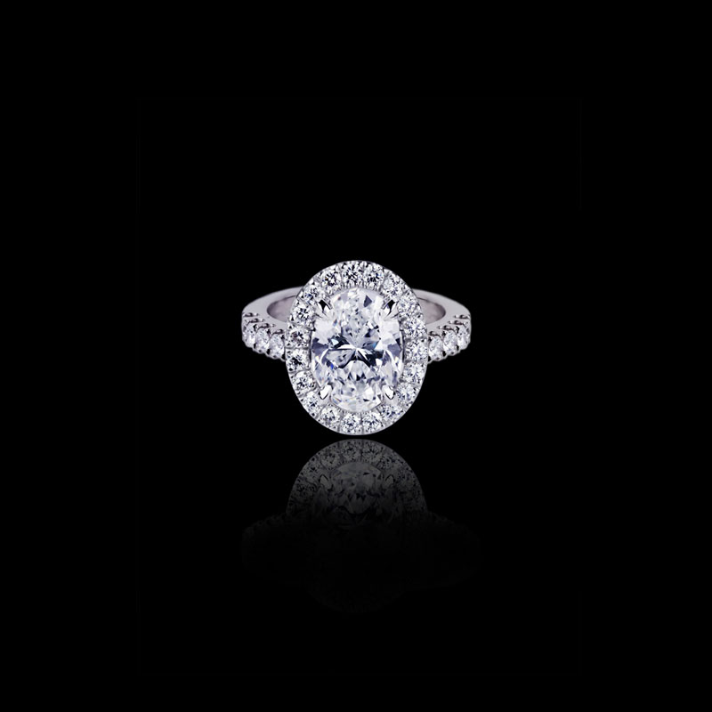 Canturi Renaissance diamond engagement ring in a scalloped set halo available with an oval cut diamond (shown) or a variety of diamond shapes and sizes. In 18kt white gold, also available in yellow or pink gold.