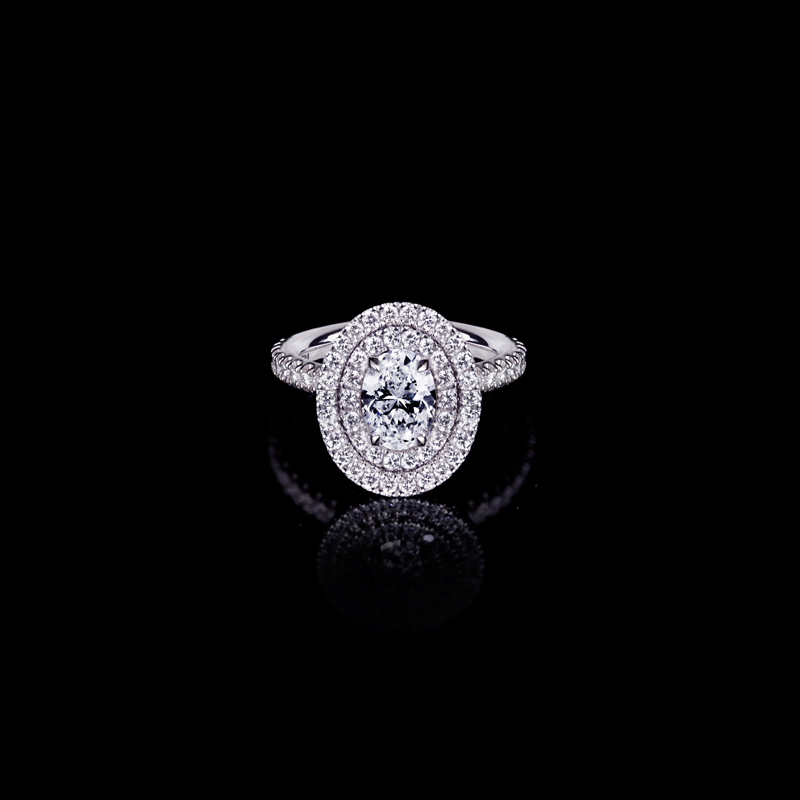 Canturi Renaissance diamond engagement ring in a double scalloped set halo available with an oval cut diamond (shown) or a variety of diamond shapes and sizes. In 18kt white gold, also available in yellow gold, pink gold and platinum.