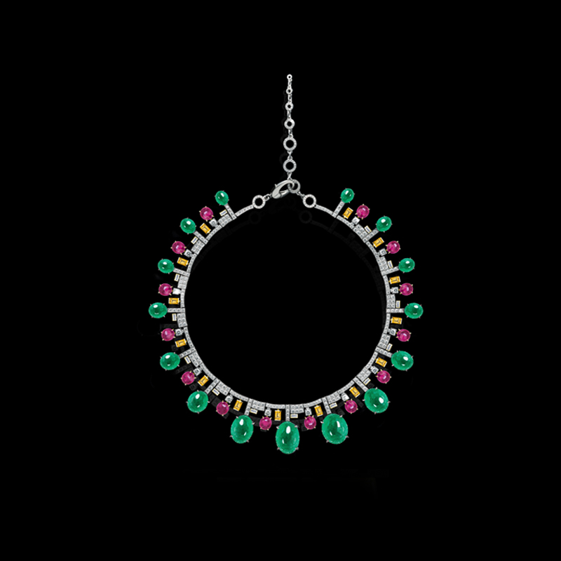 Cubism Starburst necklace with diamonds, cabochon colombian emeralds, pink tourmalines and yellow sapphires in 18ct white gold.