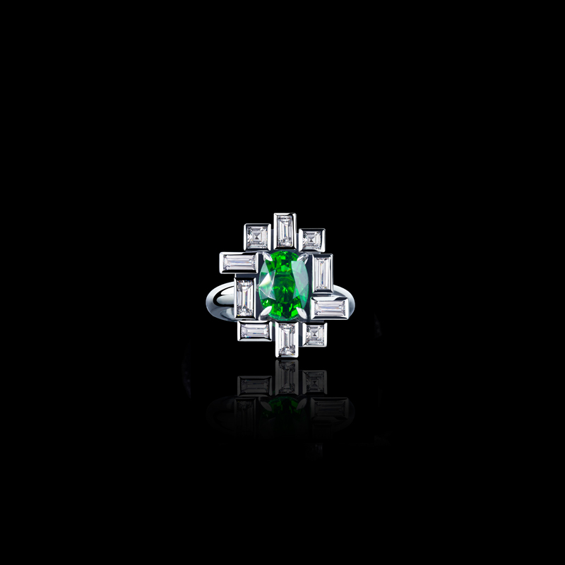 Cubism 'Stella' bezel set diamond ring with Oval tsavorite garnet in 18ct white gold.