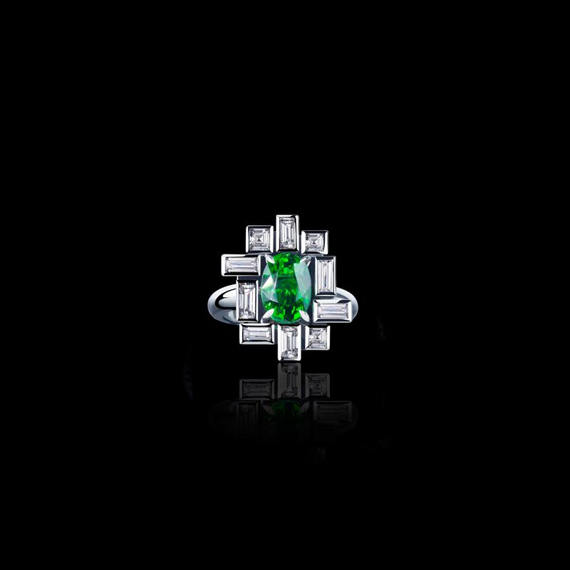 Cubism 'Stella' bezel set diamond ring with Oval tsavorite garnet in 18ct white gold.