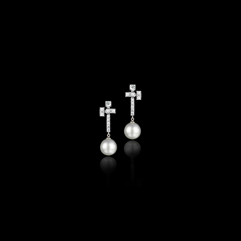 Canturi Cubism starburst earrings set with diamonds and Australian white south sea pearls in 18kt white gold.