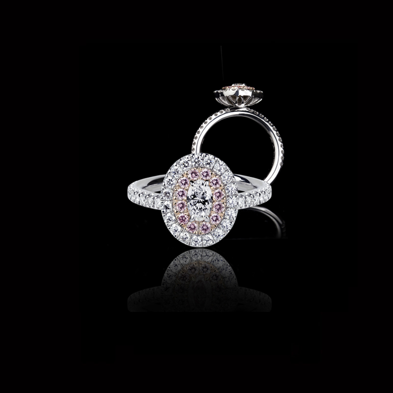 Canturi Renaissance diamond engagement ring in a double scalloped halo setting in white and pink gold, available with an oval cut diamond (shown) or a variety of diamond shapes and sizes. In 18ct white gold, also available in yellow gold, pink gold and platinum.