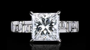 Canturi Cubism baguette and carré cut diamond engagement ring with 4 claw setting.  Available in Princess cut diamond (shown) or a variety of diamond shapes and sizes.   In 18ct white gold, also available in yellow gold.