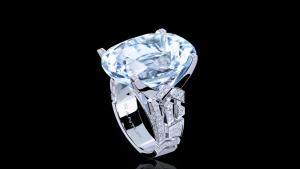 Abstract Cubism diamond ring with oval cut aquamarine gemstone set in 18ct white gold.