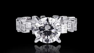Canturi Cubism Radiant engagement ring with baguette and carré cut diamonds in a pulsating design featuring a round brilliant cut diamond (shown), or a variety of shapes and sizes in 18ct white gold