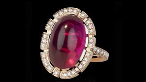 Canturi Regina halo diamond ring with oval cabochon pink tourmaline In 18ct pink gold, also available in white gold or yellow gold.