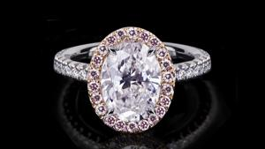 Canturi Renaissance micro scalloped pink diamond single halo ring featuring an oval cut diamond (shown) or a variety of diamond shapes and sizes. In 18ct white gold, also available in yellow gold, pink gold.