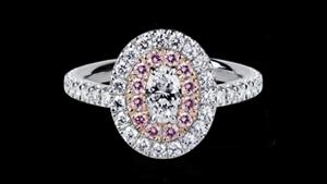 Canturi Renaissance diamond engagement ring in a double scalloped halo setting in white and pink gold, available with an oval cut diamond (shown) or a variety of diamond shapes and sizes. In 18kt white gold, also available in yellow gold, pink gold and platinum.