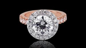 Canturi Renaissance diamond engagement ring in a scalloped halo setting available in a round brilliant cut diamond (shown) or a variety of diamond shapes and sizes. In 18kt white gold, also available in yellow gold, pink gold and platinum.