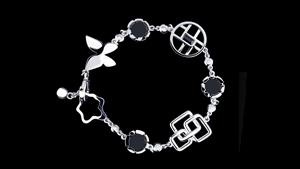 Canturi Signature bracelet with diamonds, Australian black sapphire and onyx in 18ct white gold. Also available in 18ct pink or yellow gold.