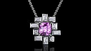 'Stella' pendant with baguette and carré cut bezel set diamonds surrounding a cushion cut pink sapphire in 18ct white gold.