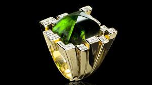'Stella' diamond and sugarloaf green tourmaline ring in 18ct yellow gold.