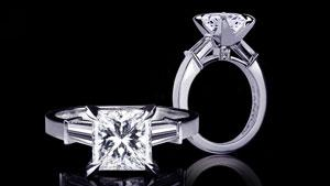 Canturi Upswept diamond engagement ring in a dream setting with princess cut diamond (shown) or a variety of shapes and sizes. In 18kt white gold, also available in yellow gold, pink gold and platinum.
