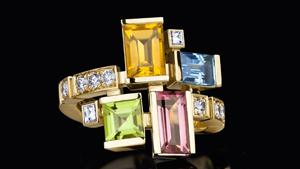 Cubism colorburst diamond and colored gemstone ring featuring pink tourmaline, blue topaz, peridot, and citrine gemstones in 18ct yellow gold.
