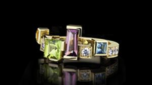 Cubism colourburst single row diamond and coloured gemstone ring featuring pink tourmaline, blue topaz, peridot, and citrine gemstones in 18ct yellow gold.